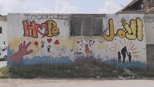 İdlibli grafiti sanatçısı, savaşın izlerini fırçasıyla siliyor