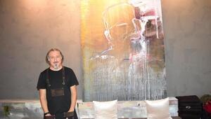 Koşuşturmaktan bunalan ressam ve iş insanı, İzmir'de kahve evi açtı