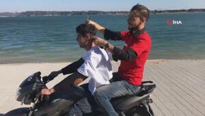 Çılgın berberden hareket halindeki motosiklette tıraş