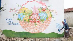 Evlerin duvarlarına çizdiği resimlerle köyünü dünyaya tanıttı