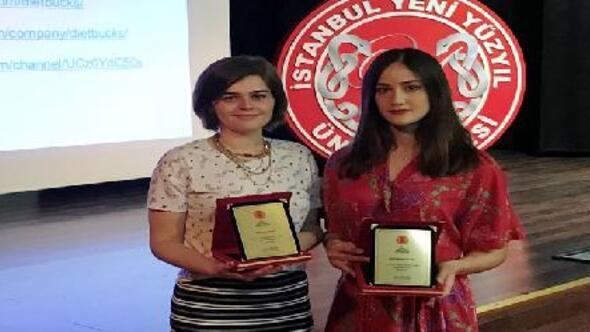 İstanbul Yeni Yüzyıl Üniversitesi'nin iki öğrencisine TÜGİAD'dan  ödül