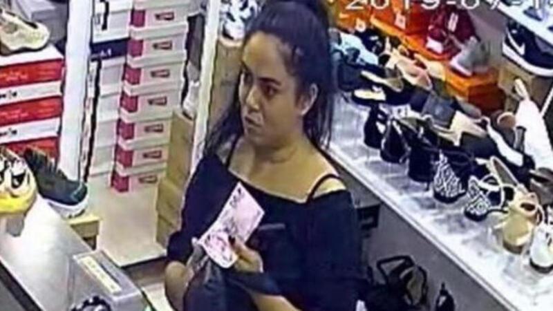 Esnaftan sahte parayla alışveriş yapan kadın kamerada